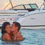 Couple Kissing in Water Behind the Cobalt R Series R7