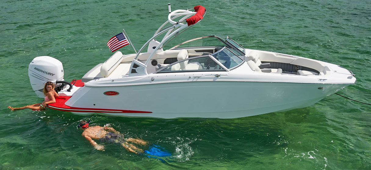 Cobalt SC Series 25 SC in White and Knockout Red with Snorkler Nearby